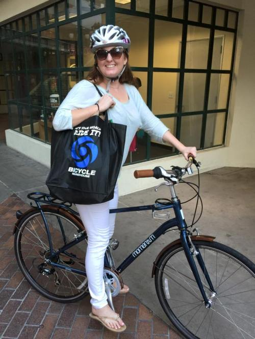 Alex is riding downtown on her Momentum Street bike carrying home her groceries in the new BW recyclable bag
